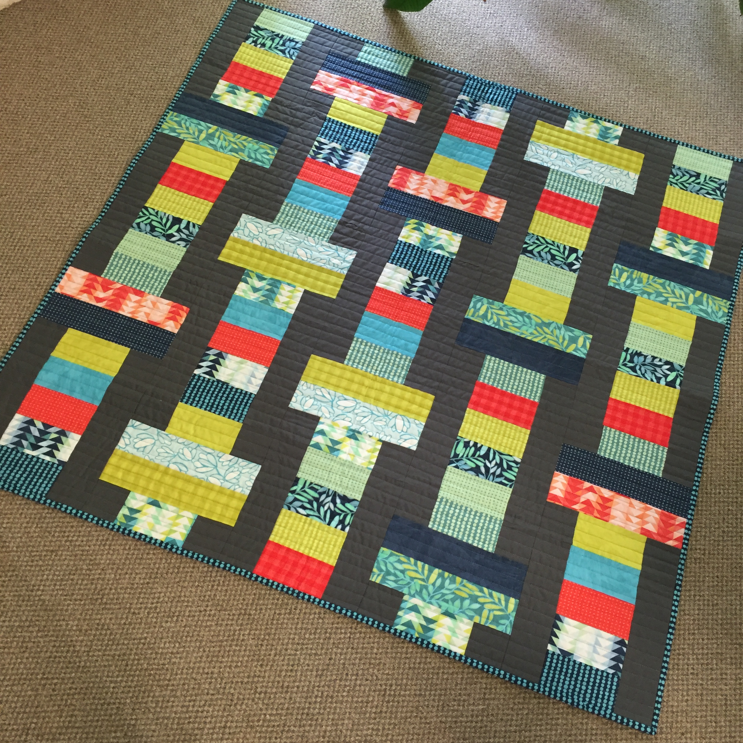 a modern binding backing mass quilt used she jelly the finished and rolls started social southeastern roll quilting cottons kona for background quilts megan runamok september guild at
